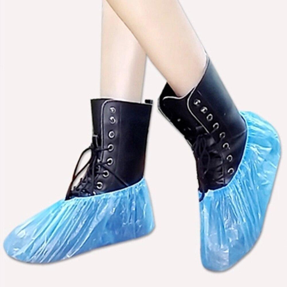 Gran oferta 100 Uds. De plástico desechable grueso exterior día de lluvia alfombra limpieza cubierta de zapato azul impermeable cubierta de zapato