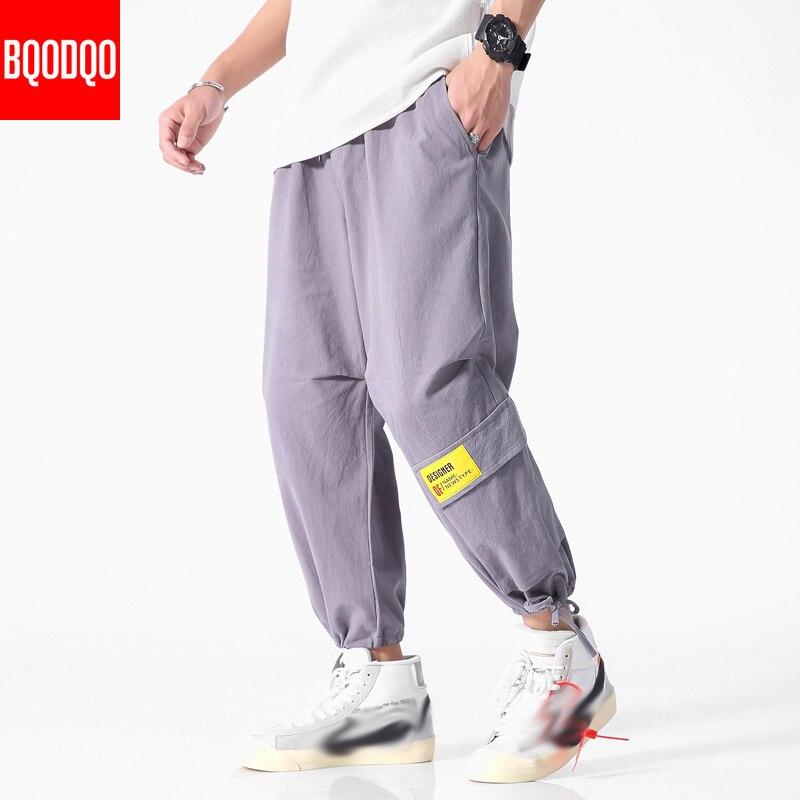 BQODQO, pantalones casuales negros con cordón para hombres, ropa de calle, pantalón de otoño militar, pantalones holgados de algodón japonés con estilo para hombres, pantalones holgados