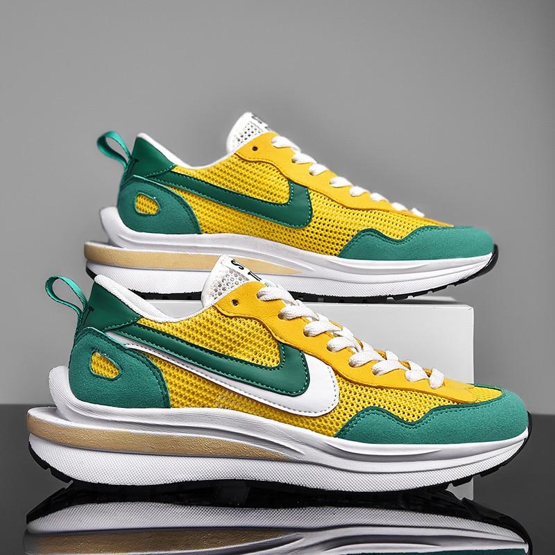 Nova high-end couro + malha sapatos esportivos casuais masculinos, moda ao ar livre leve e respirável tênis de corrida