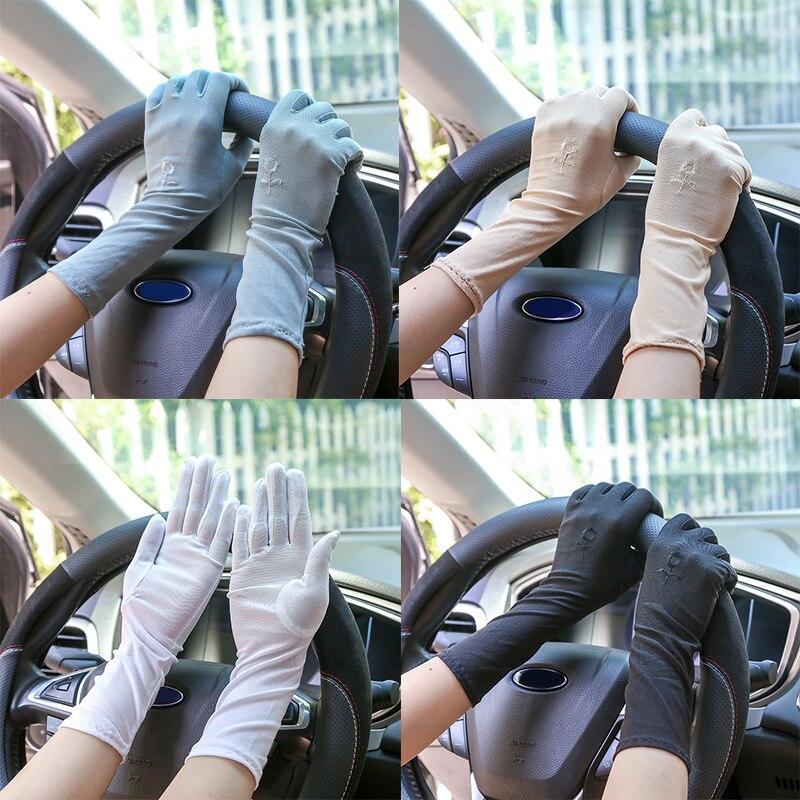 Guantes de estilo medio de Color liso de verano 1 par de guantes de protección solar para mujer guantes de conducción con flores bordadas mitones de muñeca finos para mujer
