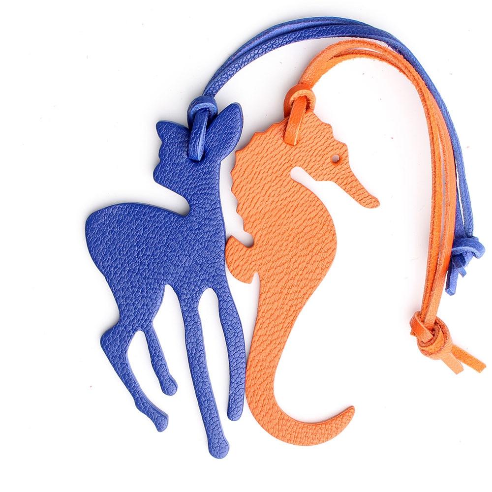 Famosa marca artesanal real couro genuíno veados seahorse chaveiro pingente chaveiro para senhoras feminino saco charme acessórios