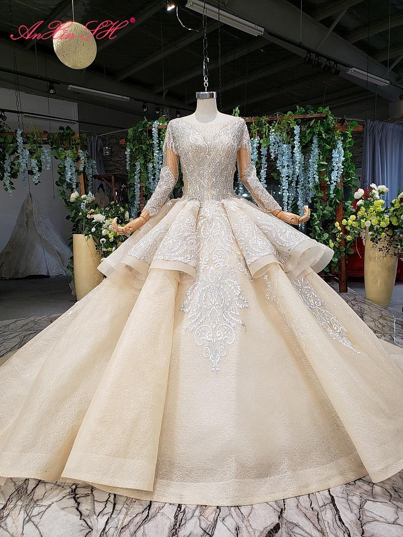 AnXin SH الفاخرة الأميرة زهرة الشمبانيا الدانتيل الكشكشة س الرقبة الخرز الكريستال الأبيض كم طويل فستان الزفاف 100% صور حقيقية