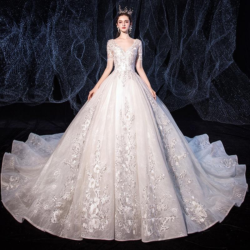 الترتر فستان الزفاف مثير العميق الخامس الرقبة شرابة قصيرة الأكمام بسيطة الديكور بلينغ الفاخرة الدانتيل يصل طويل النساء العروس فساتين B054