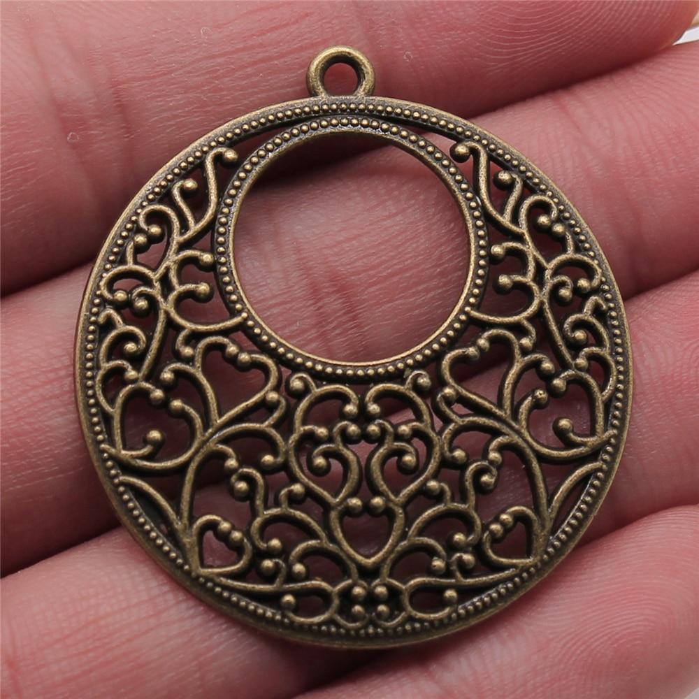 6 piezas de Color bronce antiguo 38x41mm colgante tallado redondo para hacer pendientes encantos para hacer joyas DIY hallazgos de joyería
