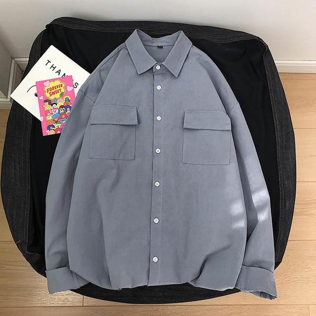 قميص أبيض بأكمام طويلة للرجال قميص أسود غير رسمي جيب الصدر 100% القطن موضة الخريف نمط جديد