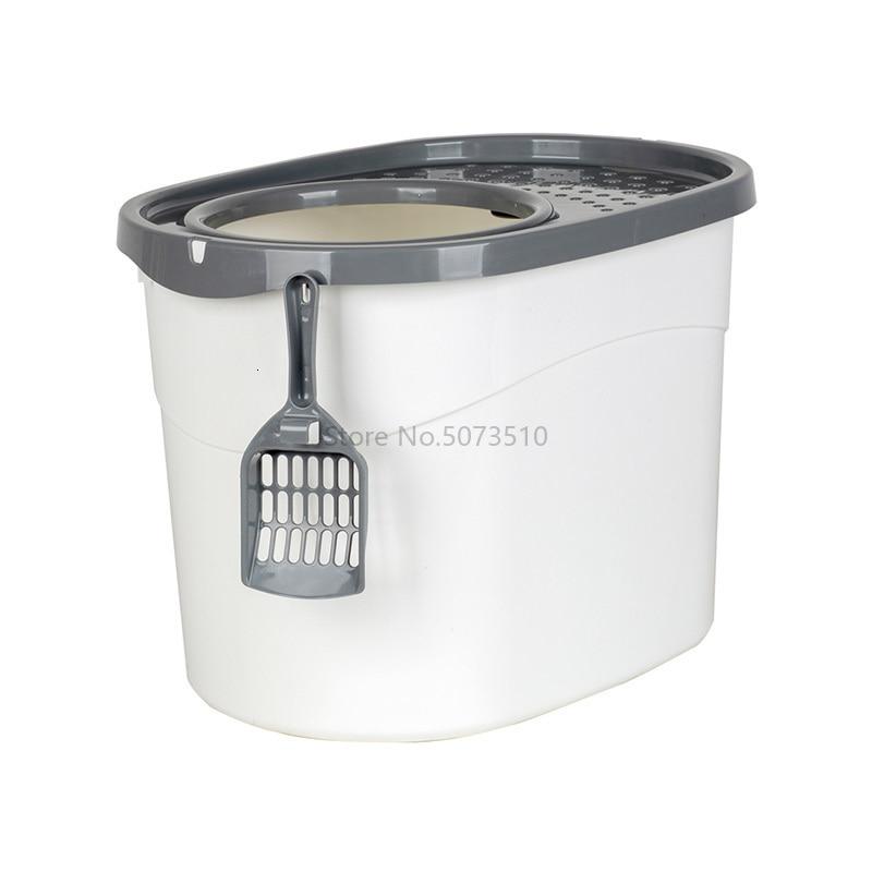 A semi-enclosed cat sandbox in a walk-in cat toilet with spatula cat supplies