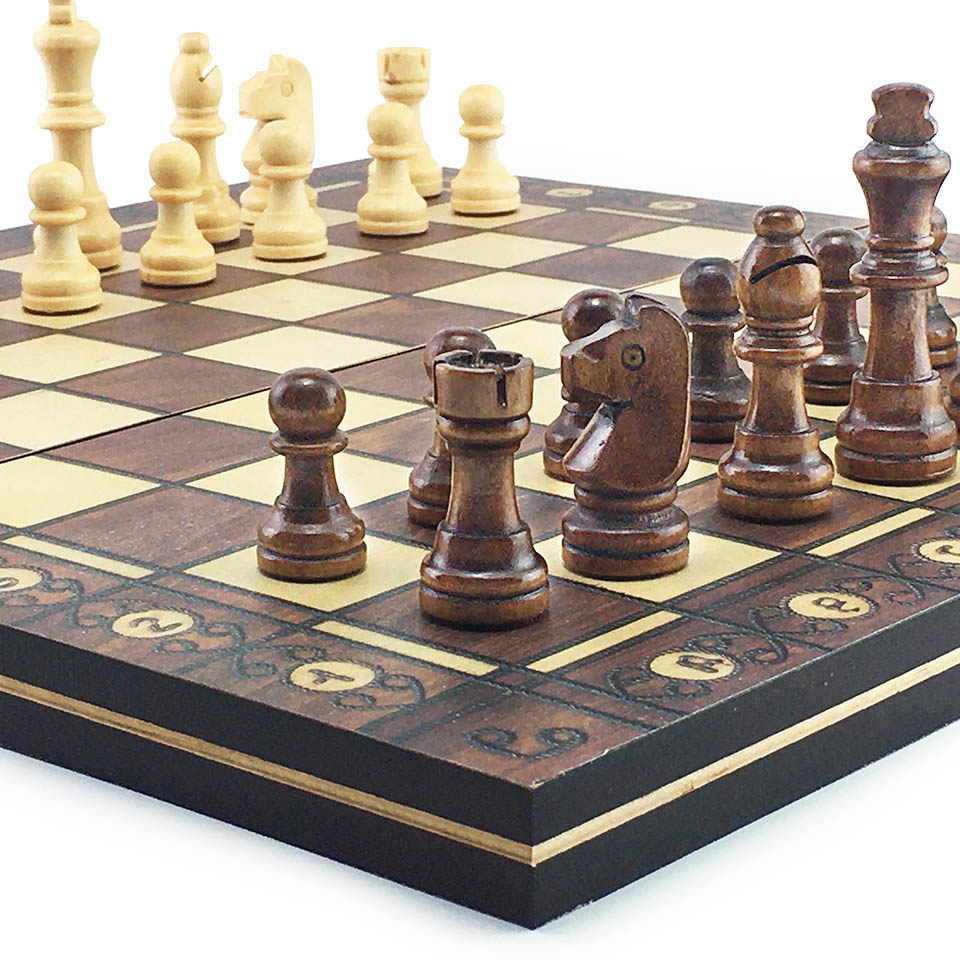 A set of wooden chess pieces without the board