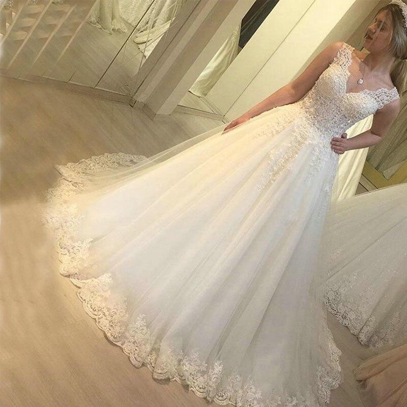 ZJ9218 الحبيب اللؤلؤ مطرز فستان الزفاف مخصص 2021 طويل بلا أكمام فساتين زفاف الأميرة الكرة