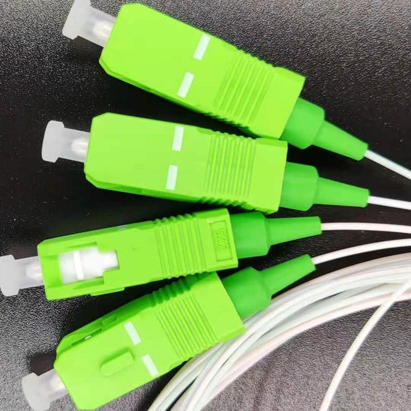 عالية الجودة 10 قطعة/الوحدة PLC 1x4 SC/APC SM 0.9 مللي متر أنابيب الصلب FTTH الألياف البصرية PLC الخائن 1 متر SC APC موصل