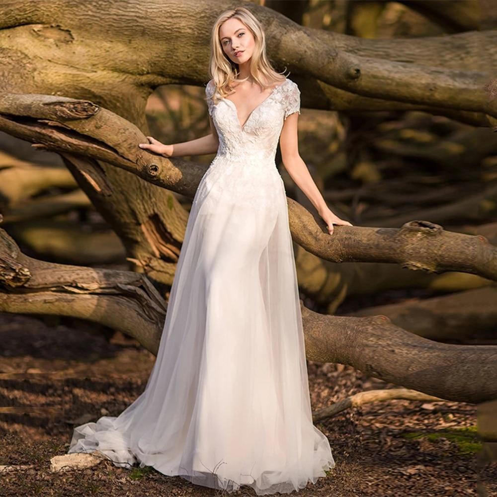 Promo Elegant Wedding Dresses V Neck Backless Short Sleeves Lace Appliques Tulle A Line Sweep Train Beach Bridal Gowns Robe De Mariée