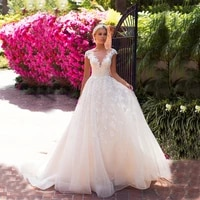 charming garden a line lace backless bride wedding gowns cap sleeves illusion bateau neck bridal dresses appliqued affordable