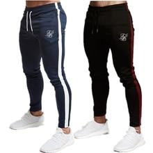 Hommes gymnases pantalon de jogging décontracté coton stretch homme dentraînement pantalons serrés pantalons de sport de haute qualité pantalon de jogging