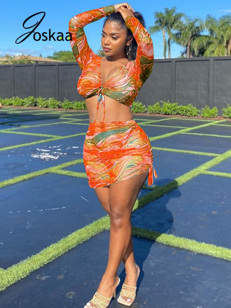 Joskaa Summer Mesh Printed Beach Suits Sexy Long Sleeve Crop Top+Bandage Bodycon Mini Skirt 2 Pcs Sets Club Outfits For Women