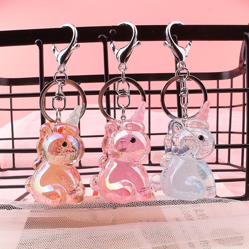 Llavero bonito de Color caramelo con forma de unicornio de cristal para mujer y hombre, llavero de campana con pintura rosa para coche, llavero con borla de cuero, bolsa al por mayor 2020