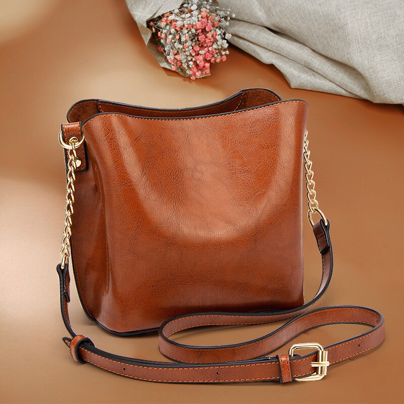 Saco portátil europeu e americano moda corrente balde saco do mensageiro das mulheres simples e versátil bolsa de ombro bolsa feminina