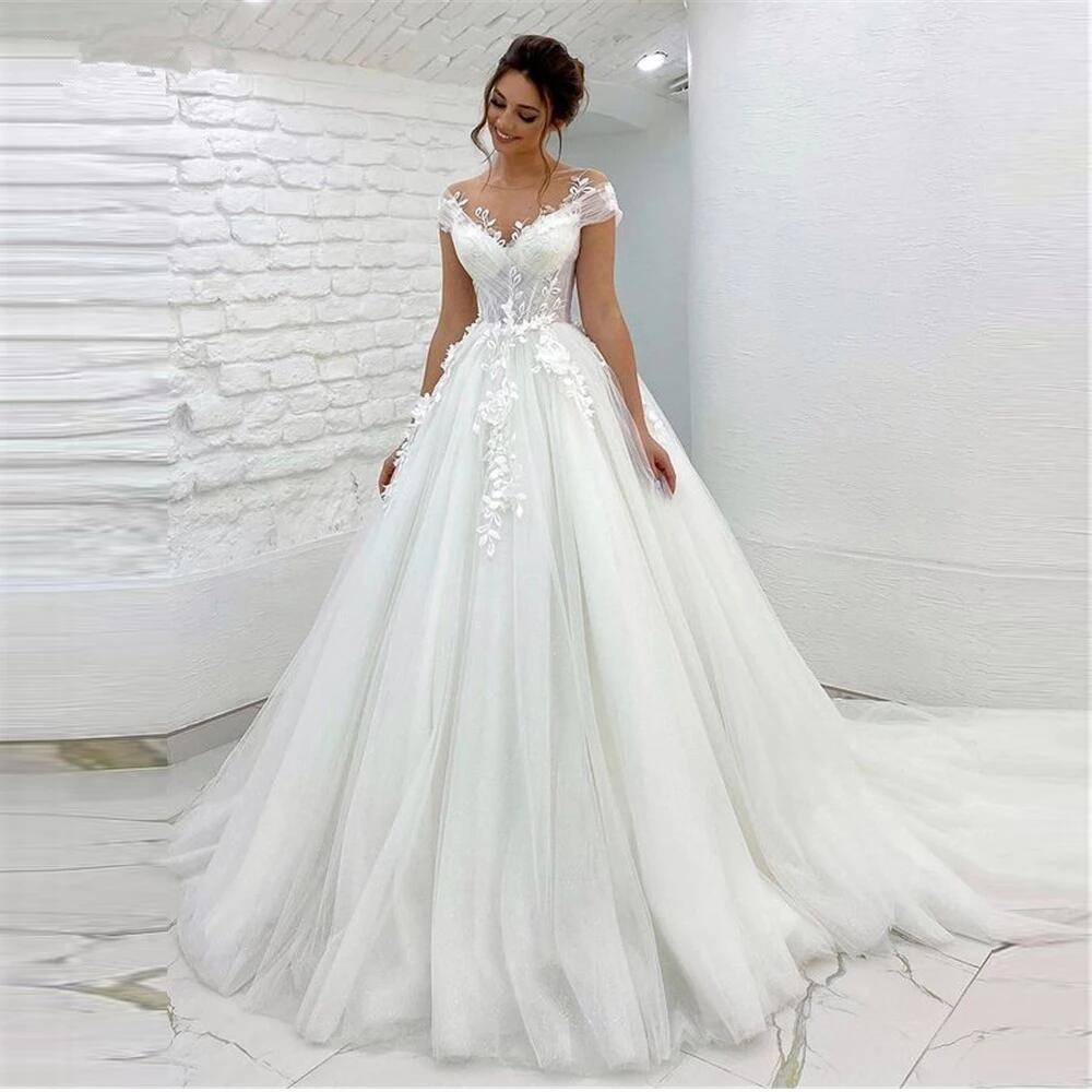 فساتين زفاف أنيقة من التل الأميرة شفافة الرقبة غطاء الأكمام الدانتيل زين مع أزرار الظهر فستان الزفاف 2021 رداء دي ماريج