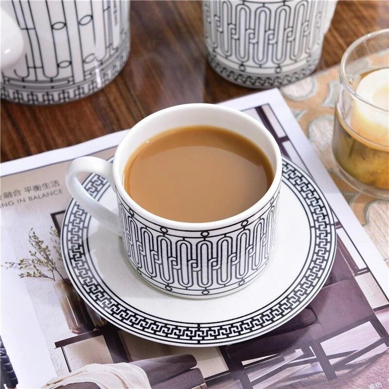 أنيقة H مارك الذهبي أعلى درجة العظام الصين فنجان القهوة الأوروبي فنجان شاي مجموعة وطبق بعد الظهر الشاي القهوة أدوات المائدة الزينة
