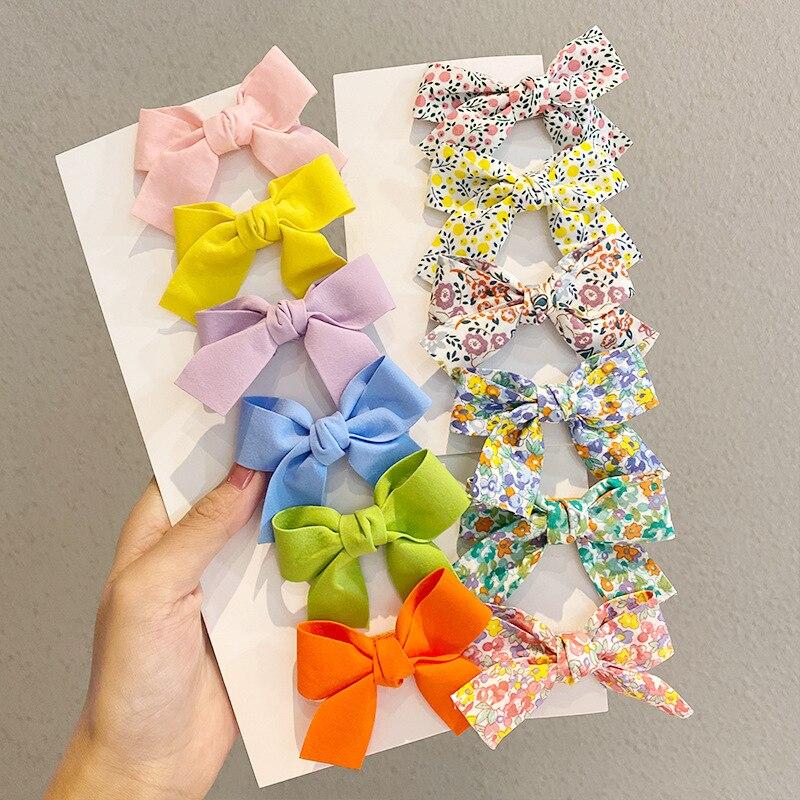 2 unids/set niñas niños Color caramelo sólido horquillas corbata de lazo Floral...