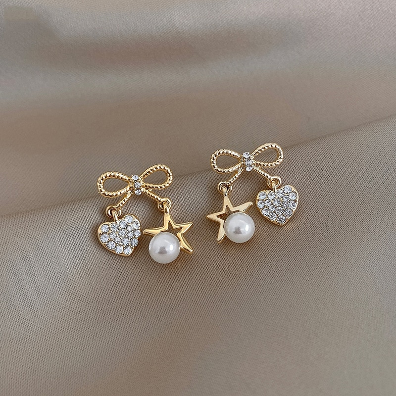 Korean version of the bowknot five-pointed star love pearl earrings female fashion personality exquisite earrings barbara cartland the star of love