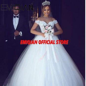 Robe de mariée en dentelle transparente, robe trapèze, épaules dénudées, traine élégante, robe de mariée en Tulle