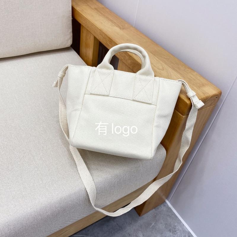 حقيبة يد نسائية أنيقة كلاسيكية أنيقة بتصميم فاخر لعام 108300 ، حقيبة حمل صغيرة من القماش ، حقيبة سفر بسيطة ، حقيبة حمل A3