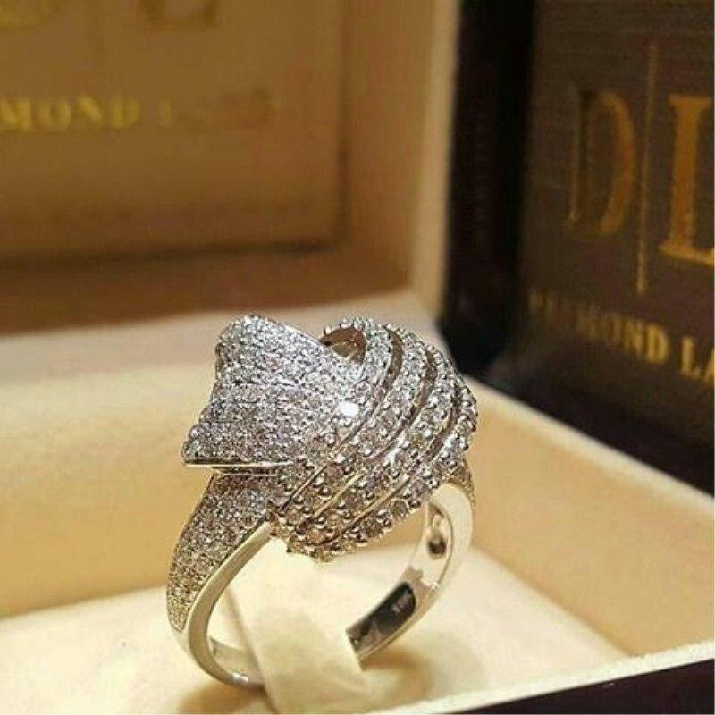 Anillo de lujo con nudo cruzado hermoso Anillo blanco CZ hueco para mujeres oro blanco lleno Retro joyería anillos de boda para promesa