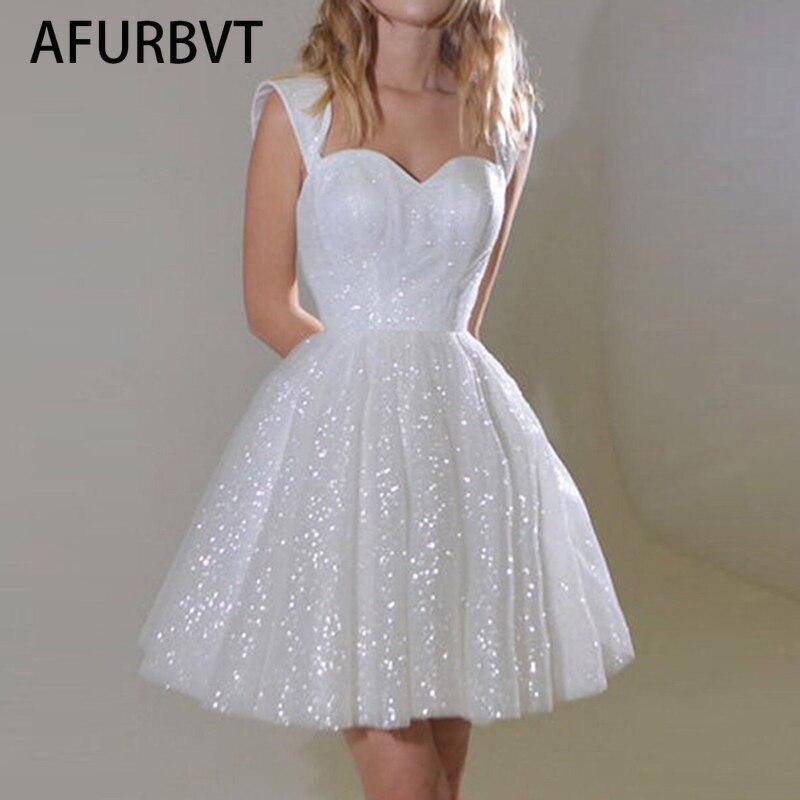فستان صيفي قصير أبيض مزين بالترتر للنساء فساتين أنيقة بياقة مربعة وأكمام قصيرة لحفلات الشاطئ فساتين نسائية