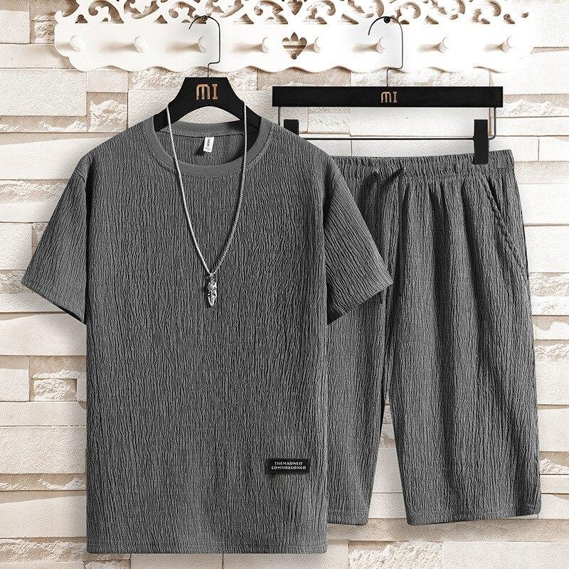 Hombres ropa 2020 verão masculino casual esportes terno shorts de duas peças de manga curta camiseta calças de seda gelo verão ultra-fino