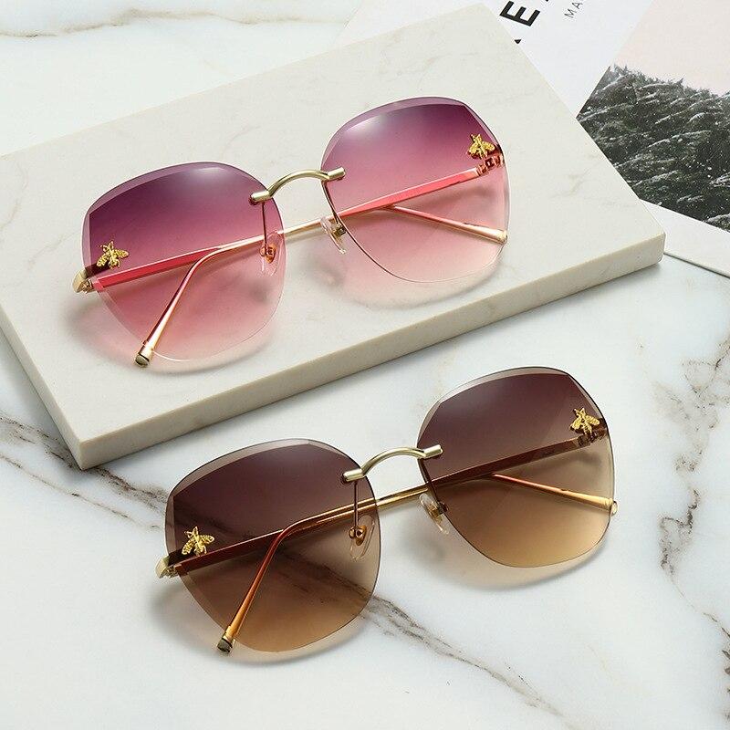 New sunglasses euramerican fashion glasses trimming frameless sunglasses metal UV400 ms sun glasses