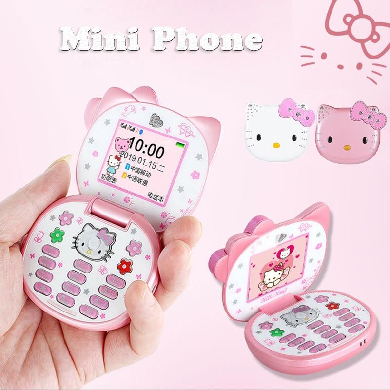 لطيف فتاة صغيرة الهواتف النقالة الوجه الكرتون المزدوج سيم بطاقة الهاتف المحمول مع مشغل MP3 FM مقفلة بلوتوث المدمجة الهاتف GSM