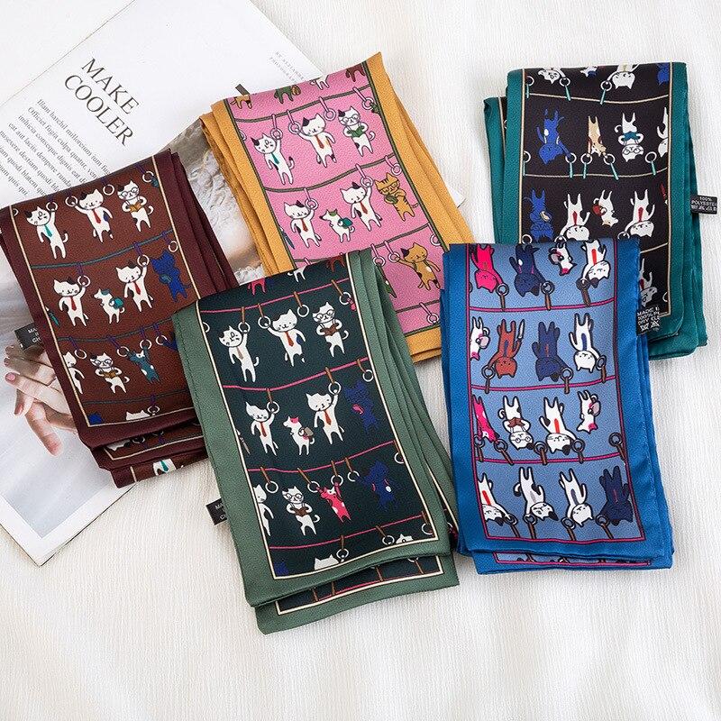 Versión coreana de la nueva bufanda con estampado de gatos, bufanda para mujer, banda para el pelo de verano, bufanda de seda sintética, venta al por mayor, moda femenina de alta calidad