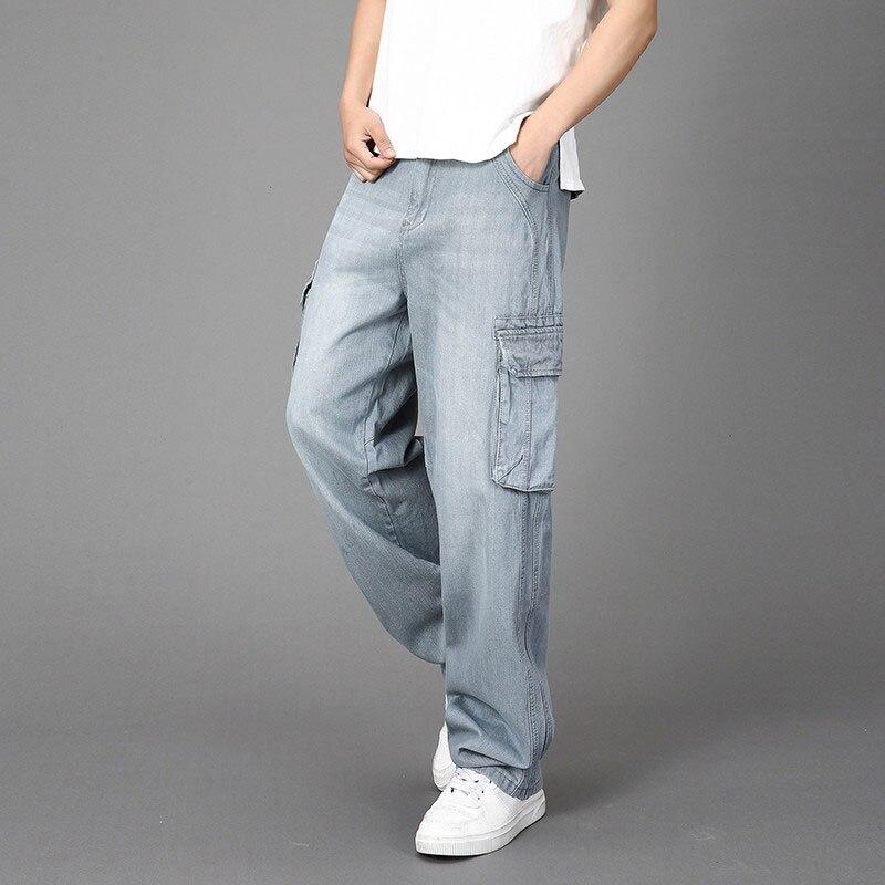 Los hombres de gran tamaño pantalones vaqueros vestidos acampanados Multi-Bolsillo gris Streetwear...