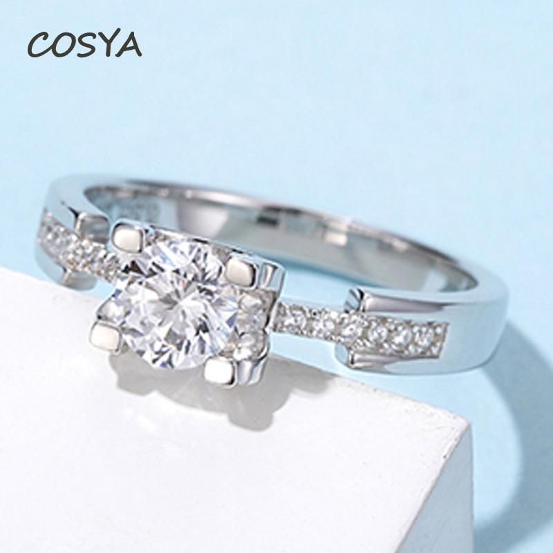 مجوهرات فاخرة من الفضة الإسترليني COSYA D Color 0.5 قيراط من مويسانيت الحقيقي 100% 925 للزفاف والذكرى السنوية للخطوبة خواتم نسائية مشرقة