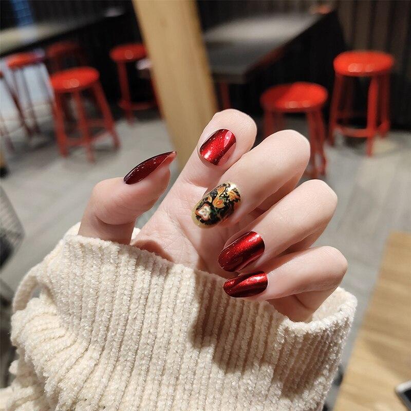 24 Uds./estampado en caja de titanio nuevos estilos moda perla luz roja falsa Prensa en uñas atmósfera medio largo ovalado uñas falsas con pegamento