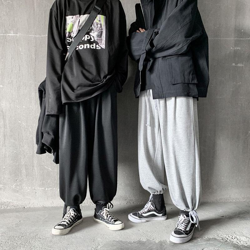 Męskie spodnie z elastyczną talią luźne spodnie z szerokimi nogawkami męskie spodnie Streetwear hip-hopowe spodnie haremowe Jogger Sweatpant odzież dla par