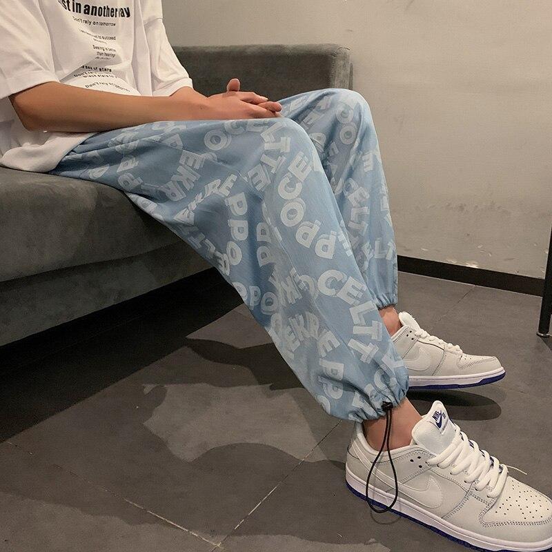 بنطلون جينز رجالي مطبوع عليه حروف جرافيك 2021 سروال دينم كوري ملابس هيب هوب مستقيمة من قماش الدنيم موضة الملابس