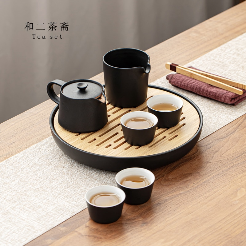 Teبينة طقم شاي المحمولة لطيف طقم شاي صيني لوتس أطقم هدايا طقم شاي أسود فاخر الصينية الكونغ فو Cuenco سيراميكا المنزل Eg50cj