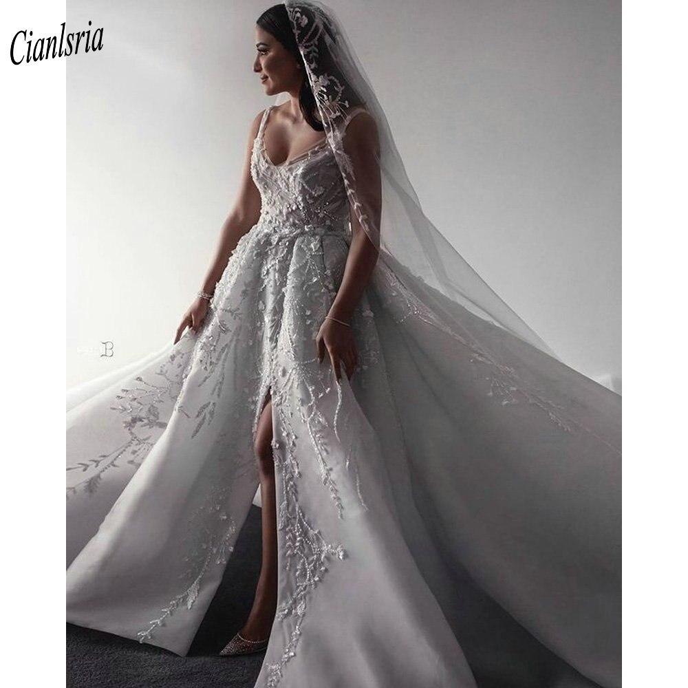 فاخر ثلاثية الأبعاد الزهور يزين السباغيتي الأشرطة دبي ألف خط فستان الزفاف بلا أكمام الخرز كريستال عالية سبليت فستان زفاف عربي