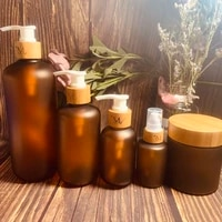 wholesale custom skin care containers amber plastic pet beauty hair tools shampoo lotion bottles cream jars with bamboo lid cap