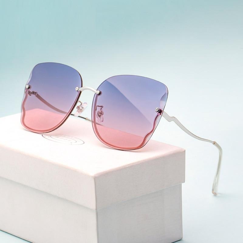 New Sunglasses Ladies Fashion Frameless Diamond Inlaid Nylon Sunglasses Female Fashion Butterfly Sunglasses Wholesale 6170