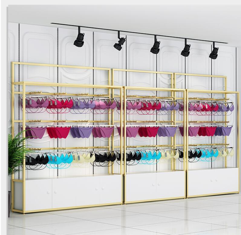 رف عرض الملابس الداخلية ، حمالة صدر معلقة ، سراويل داخلية ، أرضية ذهبية ، خزانة عرض متعددة الطبقات