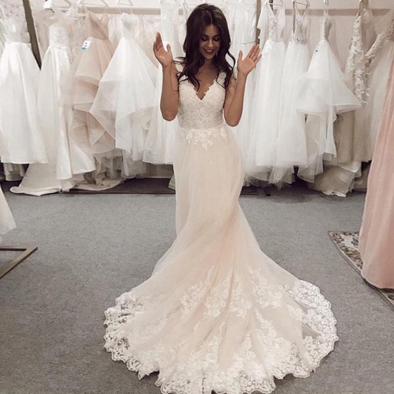 Get Elegant Wedding Dresses 2020 New Sleeveless V Neck Sexy Backless A Line Court Train Lace Appliques Bridal Gowns Vestido de Noiva