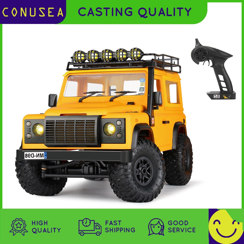 1/12 Big Rc Car MN98 2.4G 4WD Radio Controlled Truck Buggy offroad Bigfood Cars Defender with stickers lights Toys for boys Kids