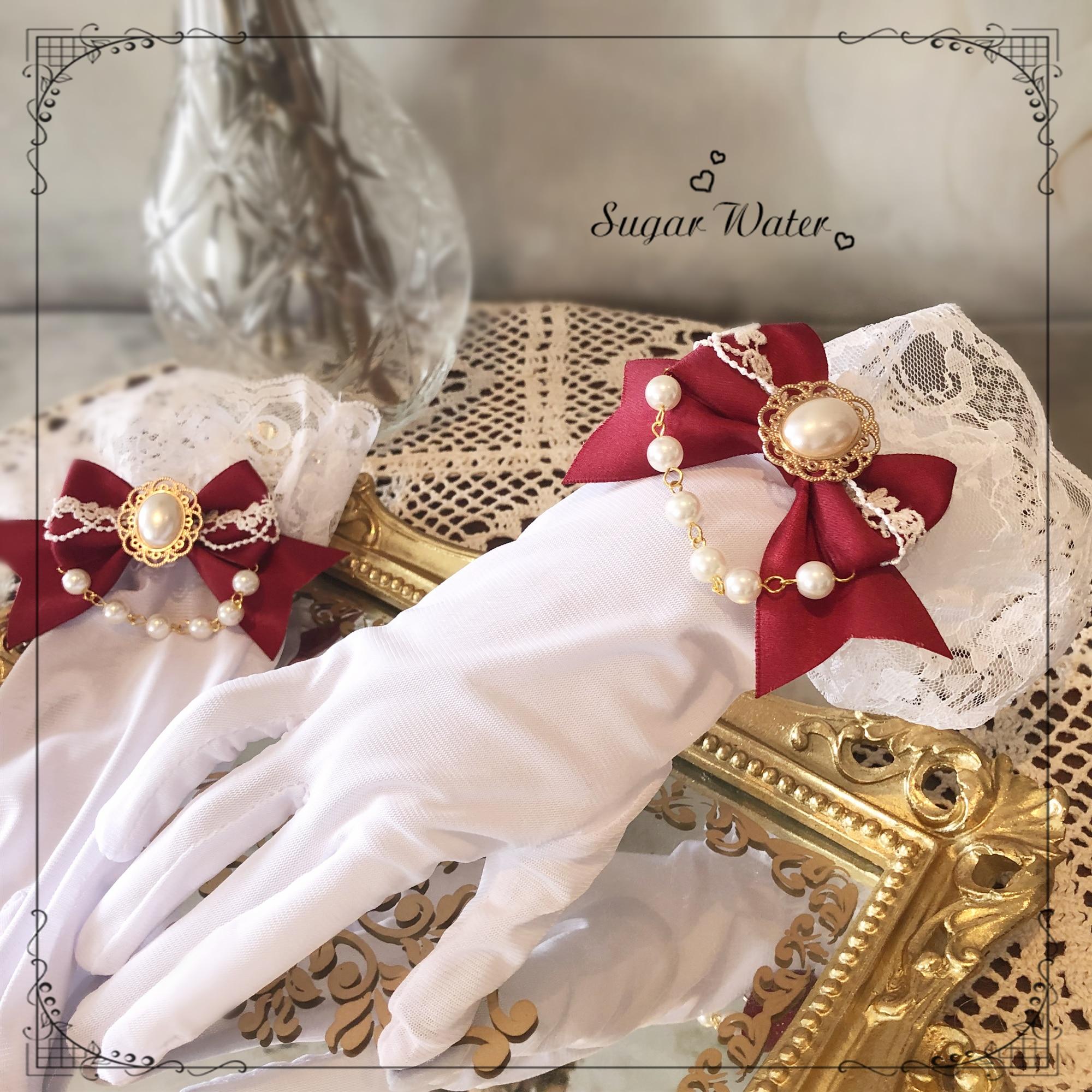 Flor boda novia hermoso arco perla cadena guantes Cosplay fiesta de té princesa suave chica dulce Lolita mano CUFF Accesorios