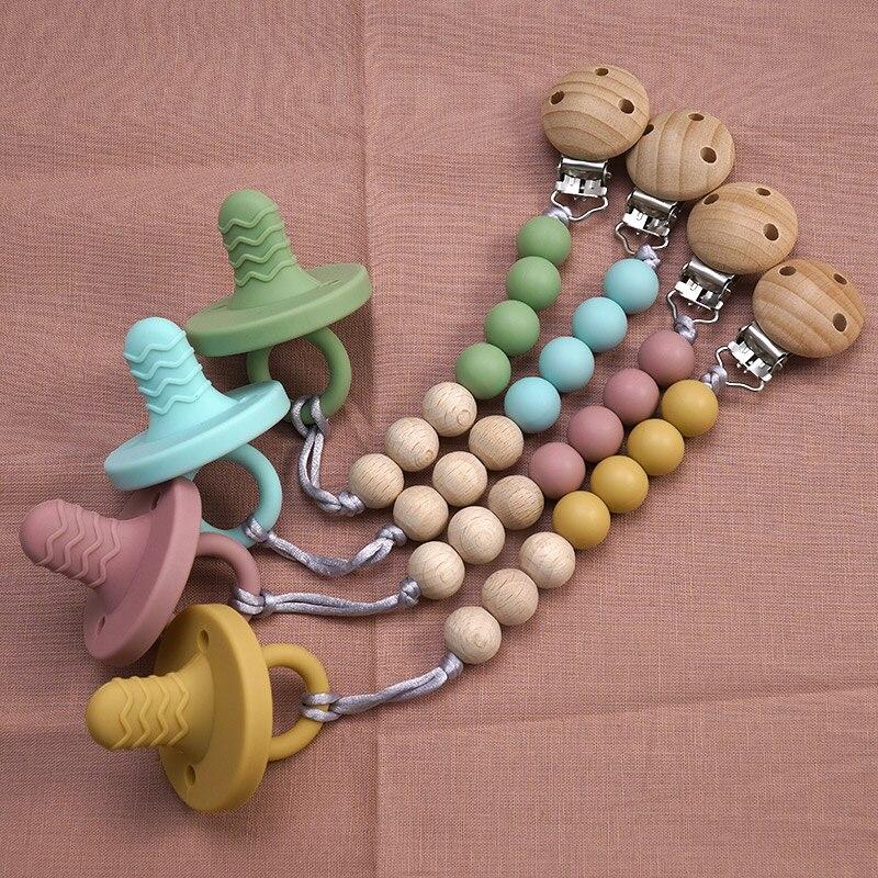 Еда Класс Новый дизайн силиконовые детские цепочка для прорезывания зубов однотонные Цвет Безопасность детская пустышка на цепочке с прищ...