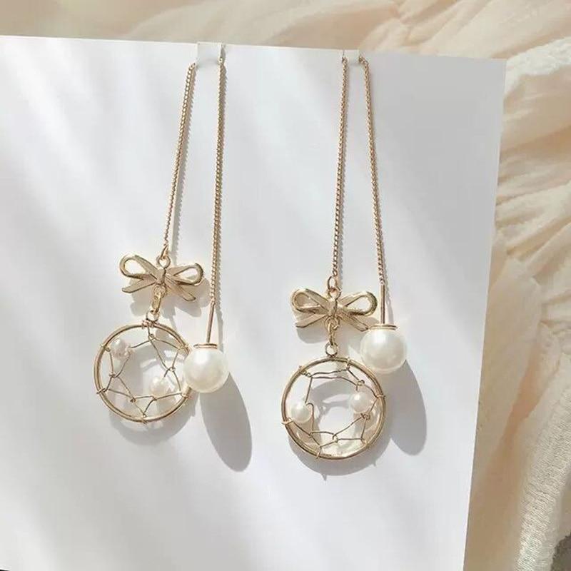 Delicate bow dream catcher tassel earrings female super fairy temperament Korean long pearl ear line