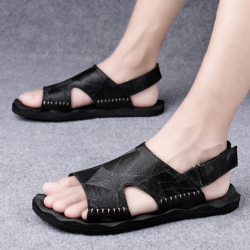 الرجال الصنادل موضة الصيف في الهواء الطلق أحذية جلد طبيعي عادية تنفس نعال شاطئ الشقق عدم الانزلاق خفيفة الوزن المصممين
