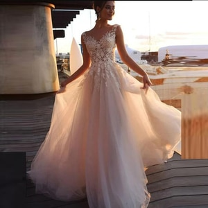 Wholesale Charming A Line Lace Wedding Dresses for Bride Cap Sleeves Illusion Bateau Neck Bridal Wedding Gowns Sheer Back