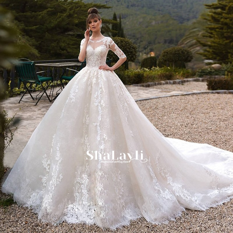 Get Luxury Wedding Dresses Half Sleeve O Neck Lace Applique Charming Gowns Sexy Backless Shiny Tulle Court Train Robe de mariée