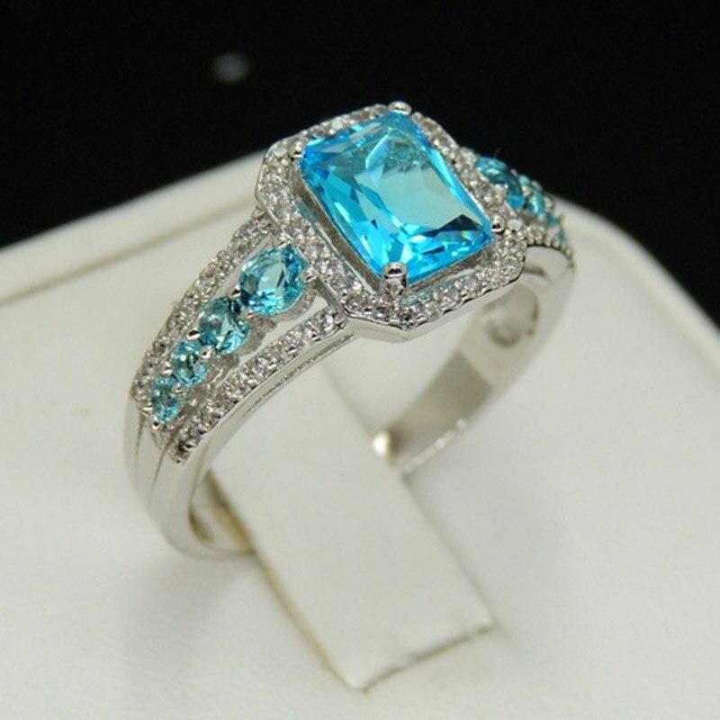 Lujo exquisito S925 azul piedra principal oval geométrica joyería señoras regalo de compromiso de boda anillo